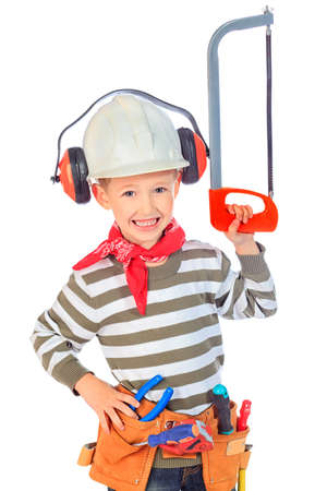 work belt: Little boy in a helmet plays in the builder with tools. isolated over white.