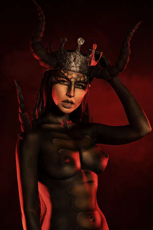 Beautiful and scary devil woman. Art project. Stock Photo - 17501705