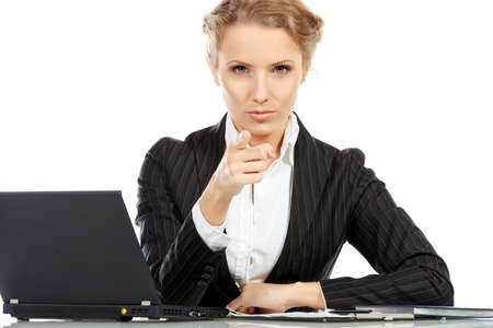 strict: Portrait of a serious businesswoman working on a laptop. Isolated over white.