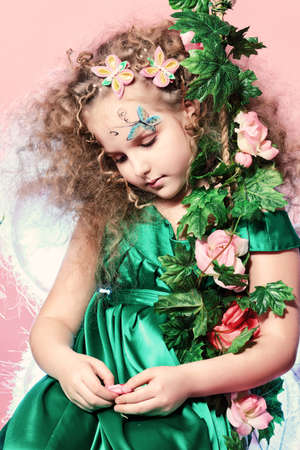 Beautiful little fairy among the thickets of ivy over pink background. Stock Photo - 17470905