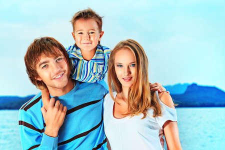 Portrait of a happy family with little son on vacation. photo