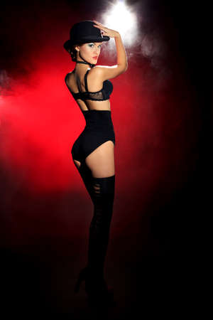 Full length portrait of a gorgeous woman in black lingerie. Retro style.  Light and shadow. photo