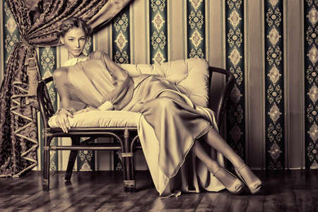Charming fashionable model posing in the vintage interior. Stock Photo - 17496181