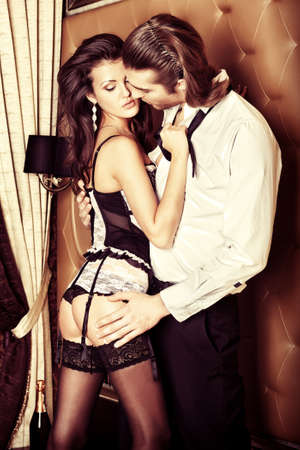sexy woman naked: Sexy young couple playing in love games in a bedroom.
