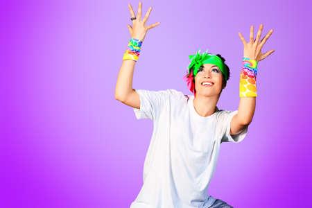 break dance: Trendy girl in headphones dancing on disco. Stock Photo