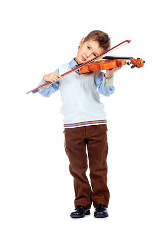 fiddle: Portrait of a boy posing with his violin. Isolated over white background.