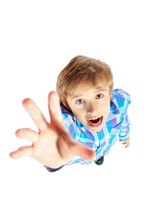 Portrait of a 9 year boy pulling his hand up. Isolated over white background. Stock Photo - 17591766