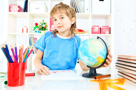 A boy doing his lessons at home. Stock Photo - 17591757