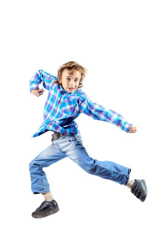 Happy boy is jumping for joy at studio. Isolated over white. Stock Photo - 17591416