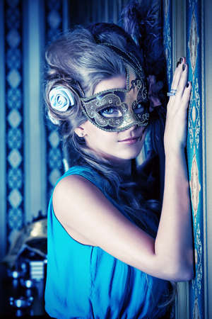 costume ball: Portrait of a beautiful young woman in a carnival mask. Vintage style. Stock Photo