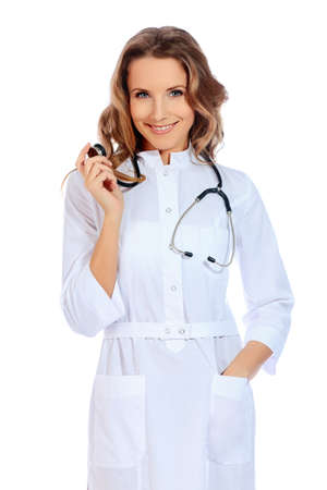 Portrait of a friendly woman doctor. Isolated over white background. photo
