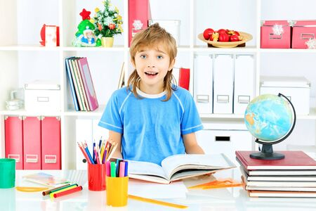 Funny boy doing his lessons at home. Stock Photo - 17591768