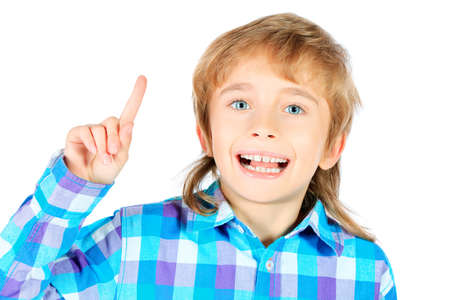 Portrait of a smiling 9 year boy draws attention to something. Isolated over white background. Stock Photo - 17594820