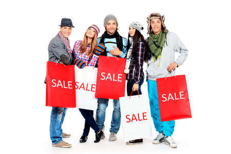 Group of cheerful young people with shopping bags. Isolated over white background. Stock Photo - 17620950