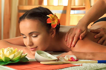 massage therapy: Beautiful young woman taking spa treatments at the salon. Stock Photo