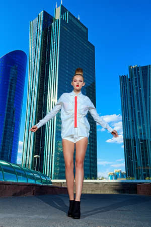 Full length portrait of a fashion model posing over big city background. Stock Photo - 17799234