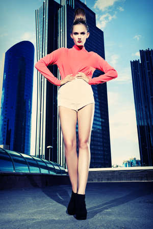 Full length portrait of a fashion model posing over big city background. Stock Photo - 17799286
