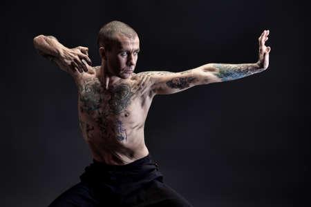 meditation man: Handsome man shows different yoga exercises over black background.