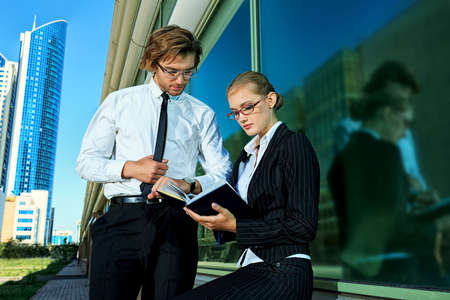 Business people standing in a big city over modern buildings Stock Photo - 23945086