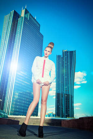 Full length portrait of a fashion model posing over big city background. Stock Photo - 17892715