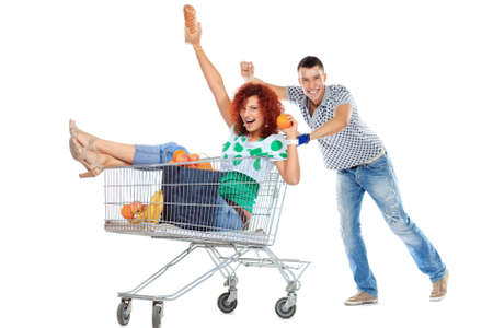 happy couple white background: Cheerful couple with a shopping trolley. Isolated over white background.