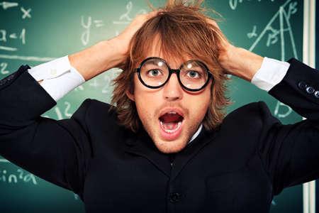 Portrait of a stressed male student near the blackboard.  Stock Photo - 17923703