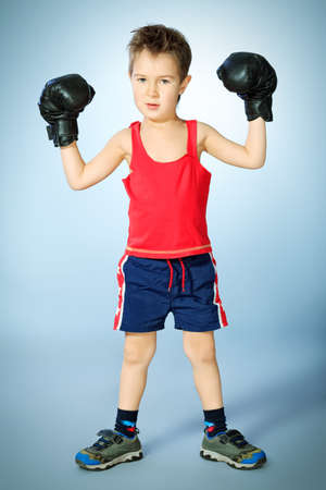 Portrait of a sporty boy engaged in boxing. photo