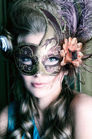 eye mask: Portrait of a beautiful young woman in a carnival mask. Vintage style. Stock Photo