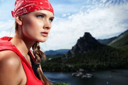 emotional freedom: Young woman tourist is looking into the distance at the top of a mountain. Stock Photo