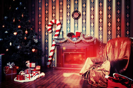 Christmas home decoration with tree, gifts and fireplace. photo