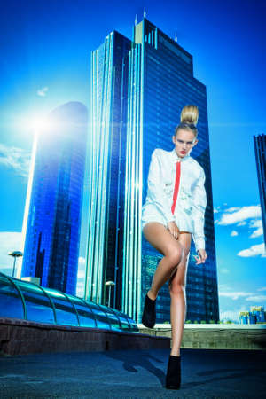 Full length portrait of a fashion model posing over big city background. Stock Photo - 18207162