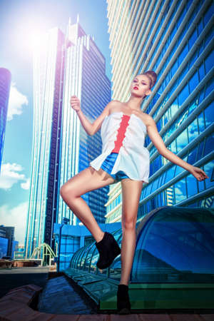 Full length portrait of a fashion model posing over big city background. Stock Photo - 18207194