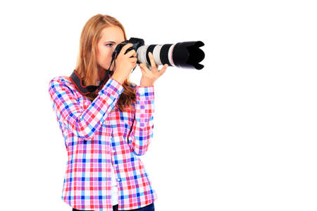 shootting: Pretty young woman taking pictures on the camera. Isolated over white.