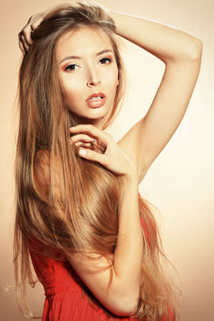 Beautiful blonde woman with magnificent long hair. photo