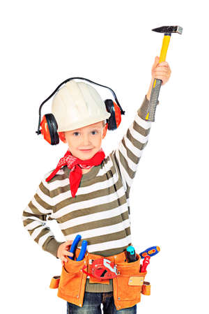 tools belt: Little boy in a helmet plays in the builder with tools. isolated over white.
