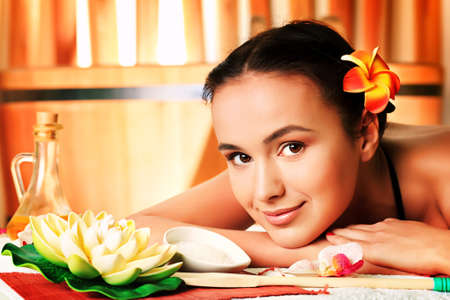 Beautiful young woman taking spa treatments at the salon. photo