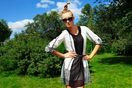 Fashion woman posing at the summer park. photo