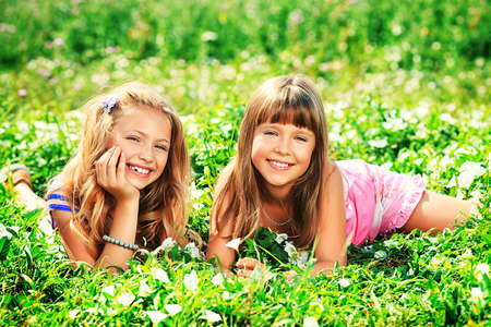 Two happy summer girls having fun outdoors.