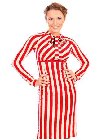 Portrait of a charming woman in extravagant striped dress. Isolated over white. photo