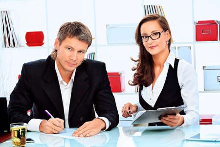 Business woman and businessman working at the office. photo