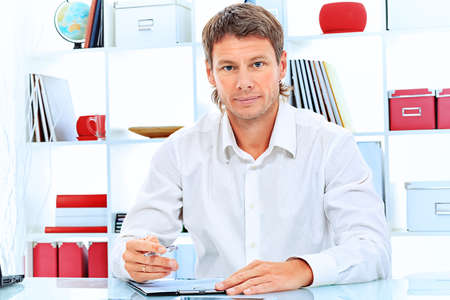 Handsome businessman is working at the modern office. photo