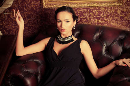 Beautiful young woman in a  luxurious classic interior. photo
