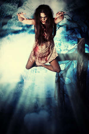 dracula woman: Bloodthirsty vampire flying at the night cemetery in the mist and moonlight. Stock Photo