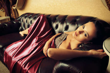 woman on couch: Beautiful young woman in a  luxurious classic interior.