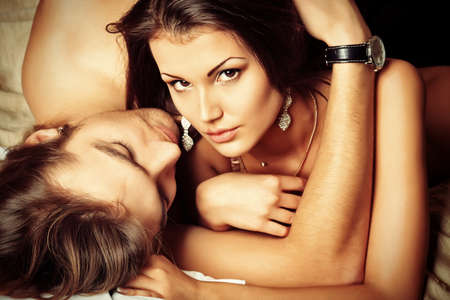 man and woman sex: Sexy young couple playing in love games in a bedroom.
