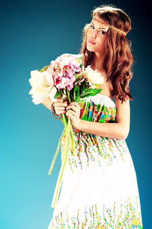 Portrait of a beautiful girl holding a bouquet of flowers. Studio shot. Stock Photo - 18715179