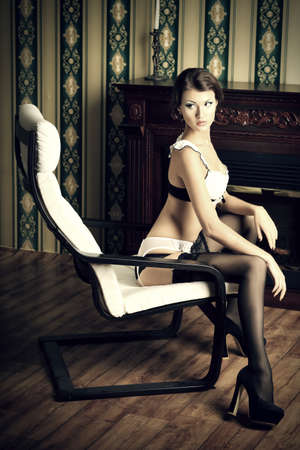 Seductive young woman in sexy lingerie posing in the vintage interior. Stock Photo - 18784194