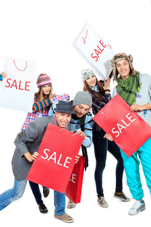 crazy woman: Group of cheerful young people with shopping bags. Isolated over white background.