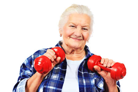 elderly exercise: Happy grandma doing exercises with dumbbells. Isolated over white. Stock Photo