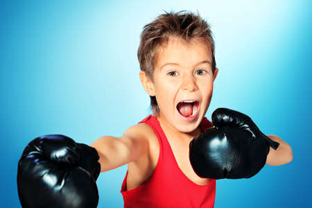 boxing boy: Portrait of a sporty boy engaged in boxing.
